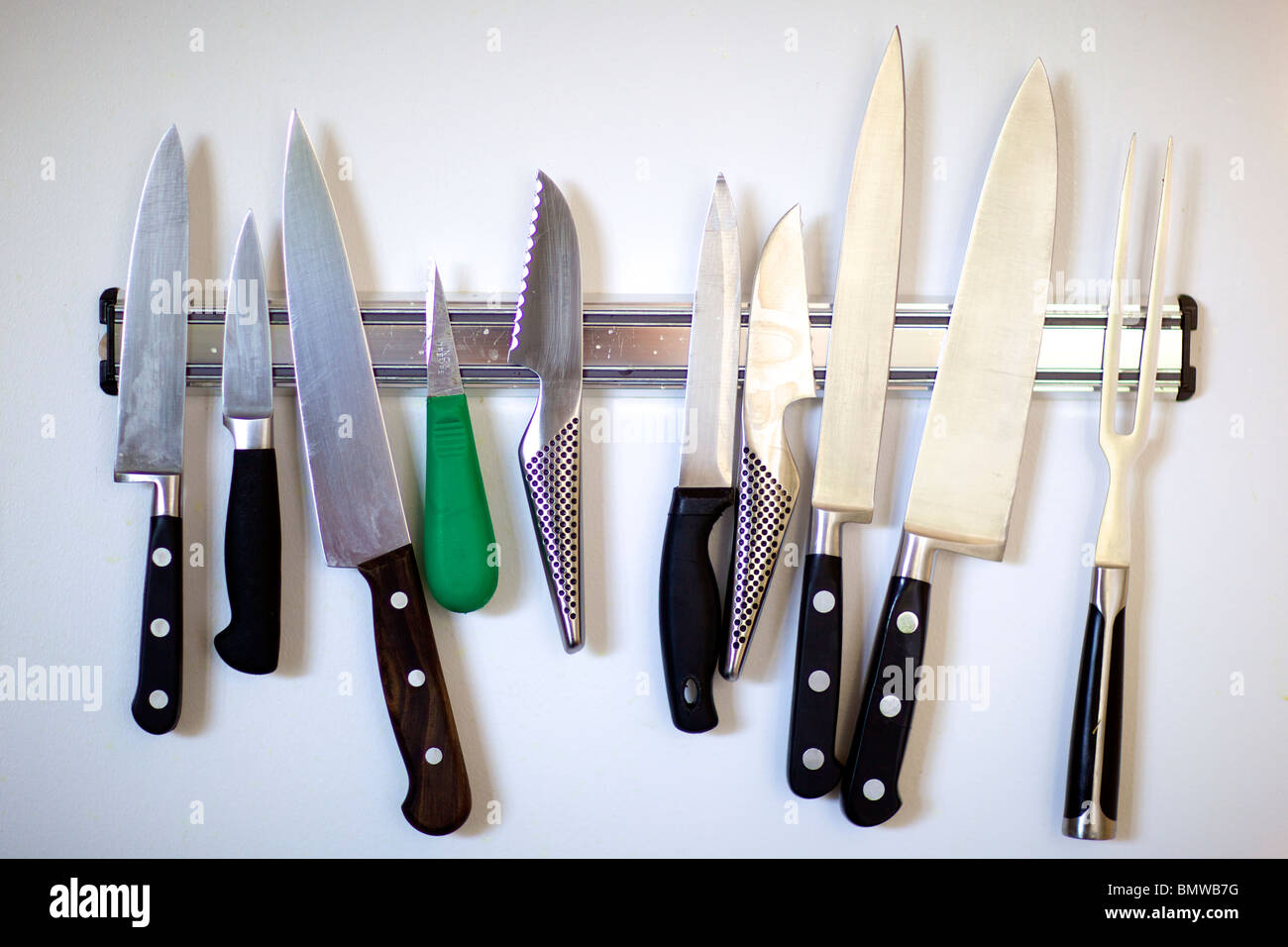 professional kitchen knives outdoor kitchens sydney hanging on a wall stock photo 30061124