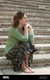 Barefoot Woman Sitting On Steps