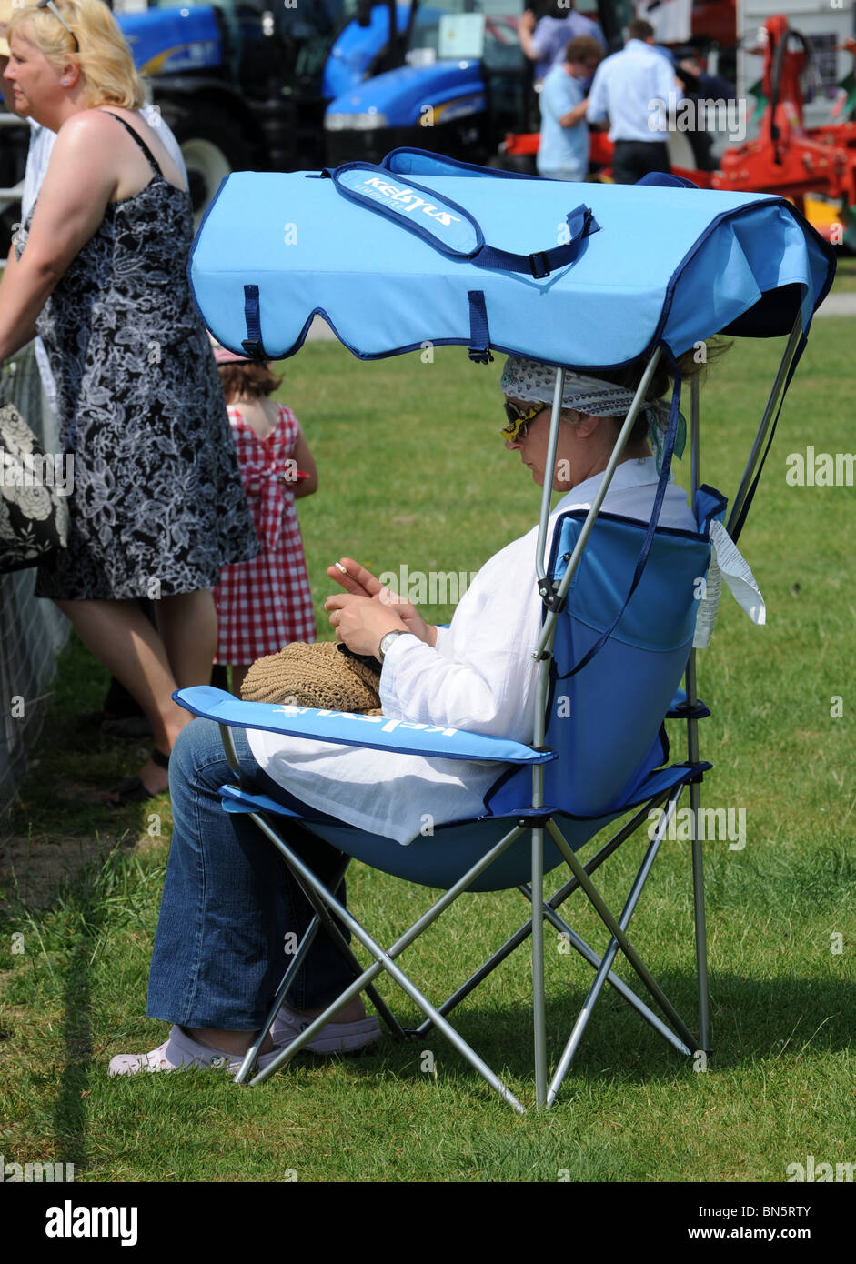 chair cover hire shrewsbury computer covers walmart woman in folding with sun shade shropshire county show stock