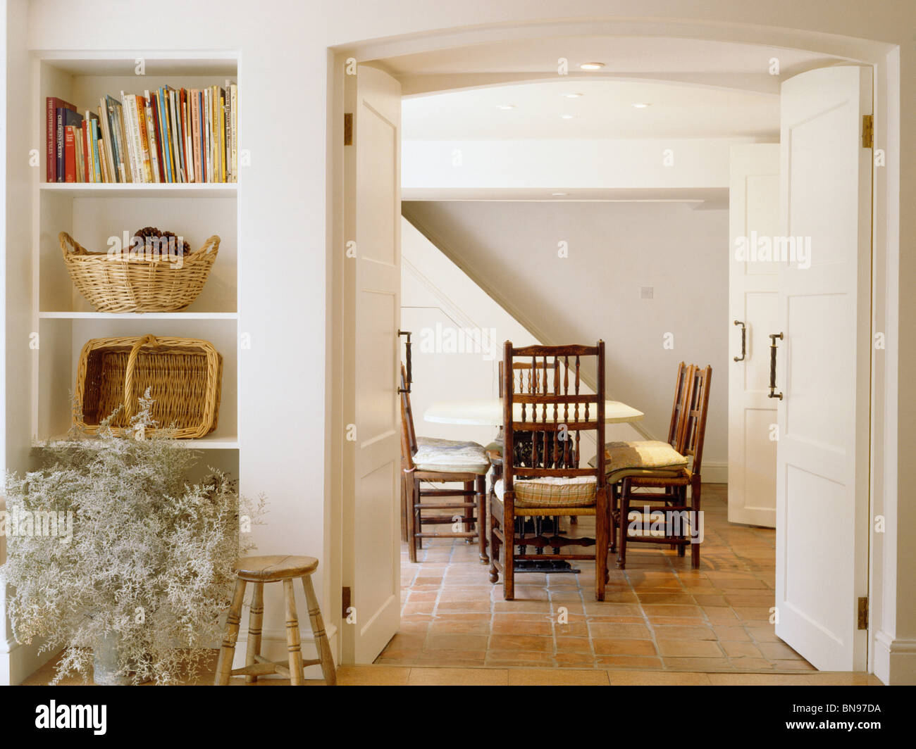 Alcove Shelves Beside Open Double Doors To Cream Country Dining Room Stock Photo Royalty Free
