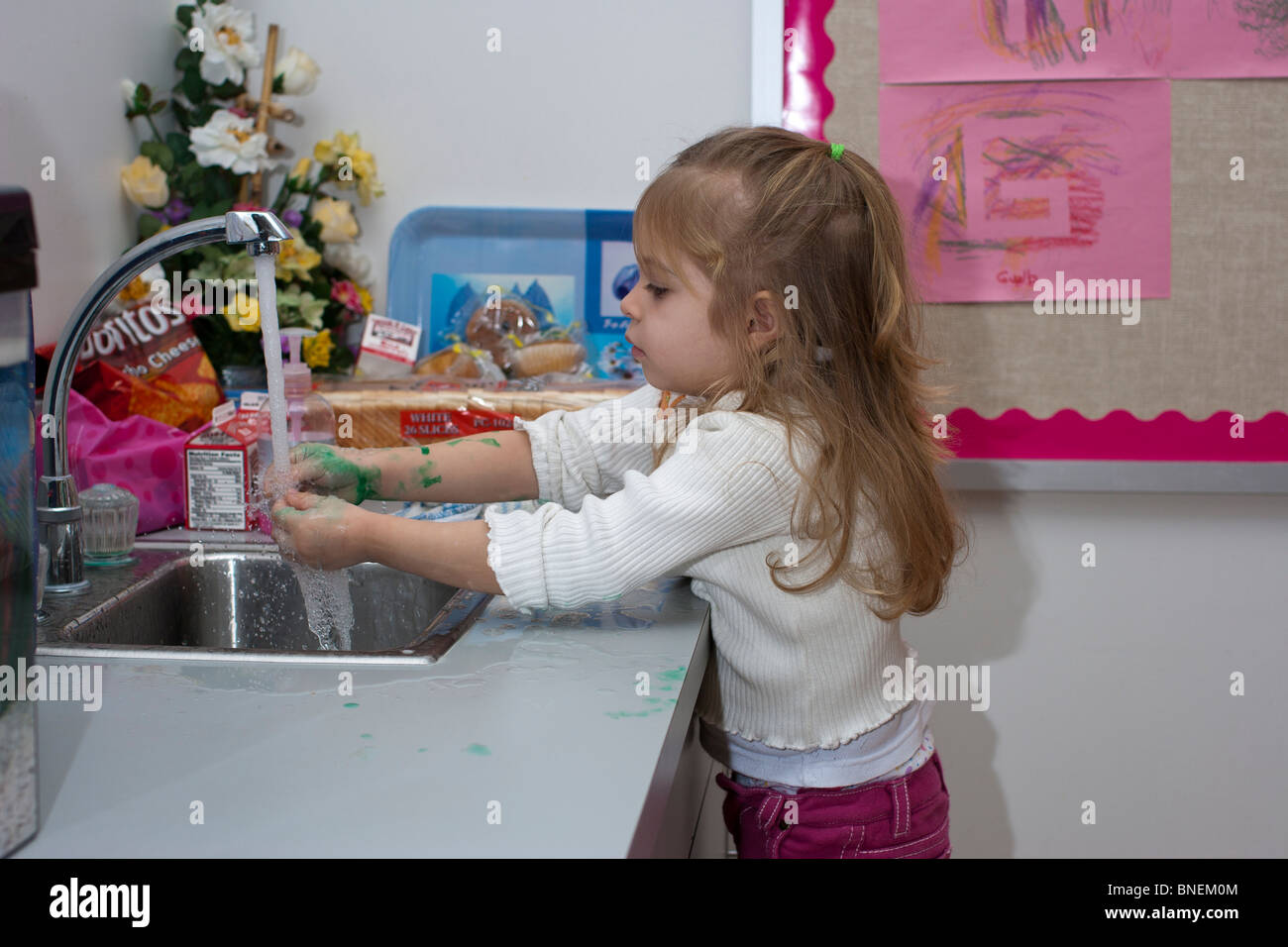 4 Year Old Blonde Caucasian Preschool Girl Washing Her Hands At The Stock Photo