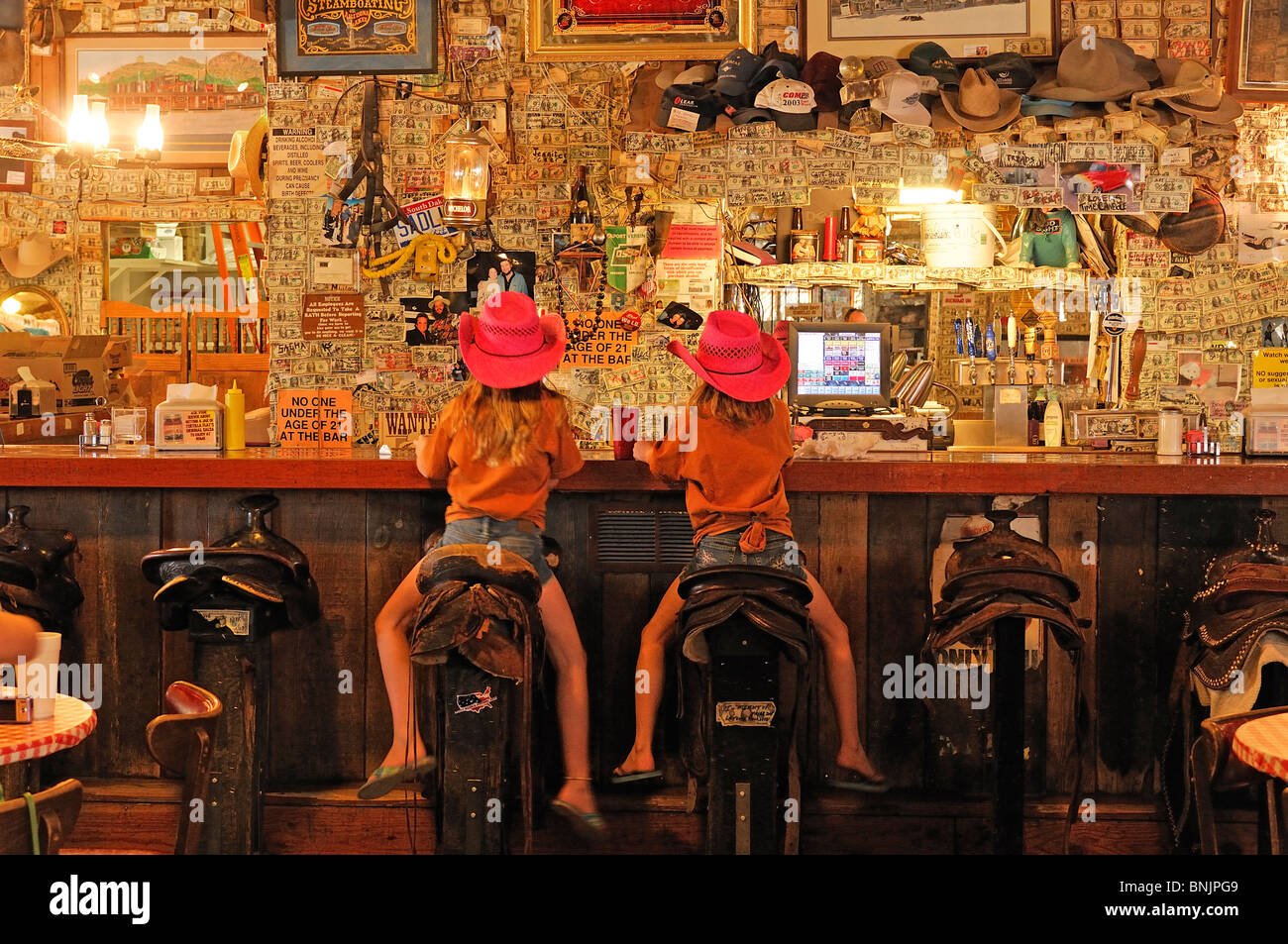 little girls chairs black sling swivel patio two children bar sitting rear view saddle superstition saloon stock photo: 30530985 - alamy