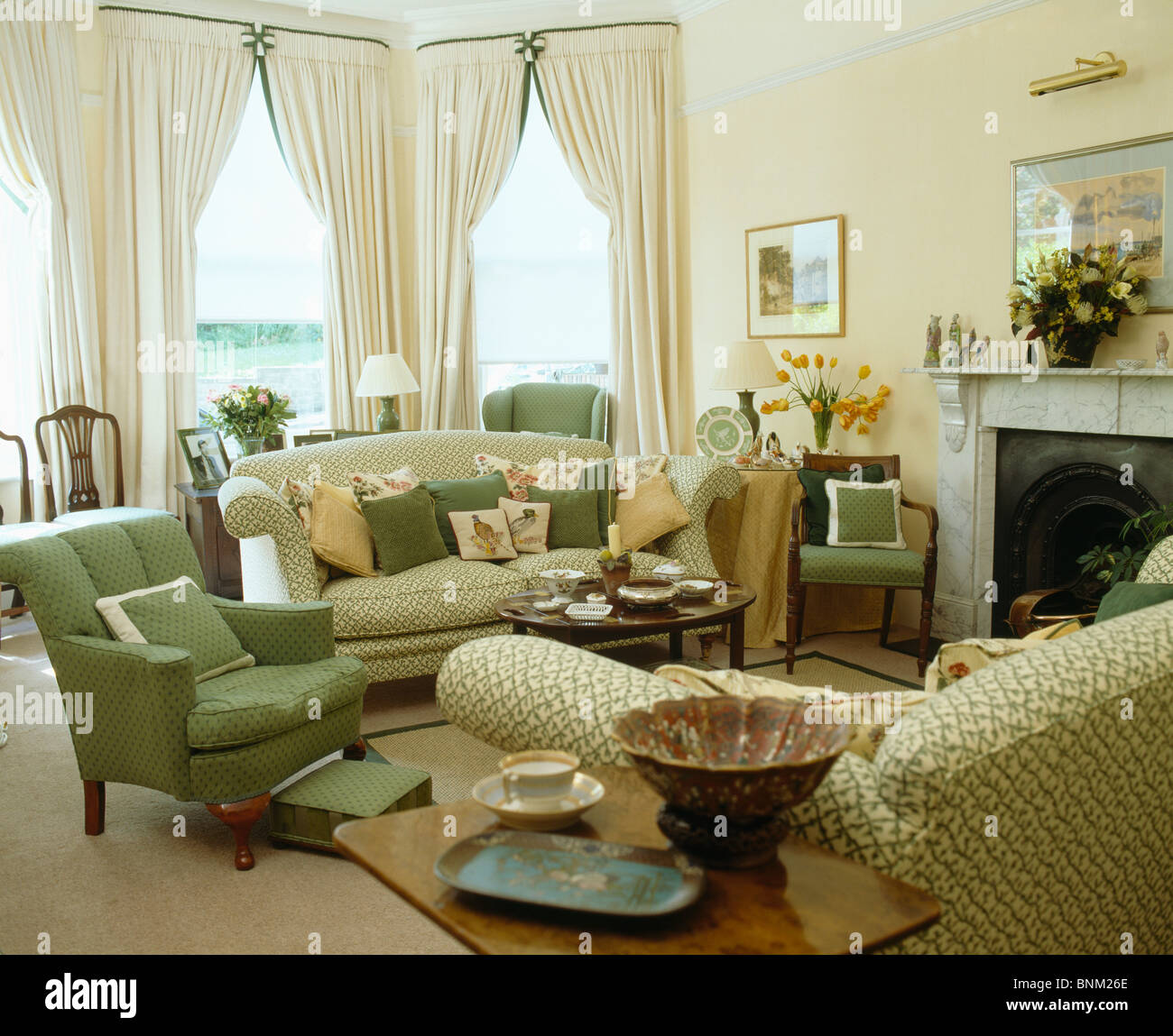 green cushions living room affordable furniture armchair and sofa piled with in traditional cream curtains on bay window