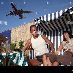Air Travel Beach Chairs Rustic Dining Room Table And A Couple In Chair Berlin Germany Stock Photo 30912978 Alamy