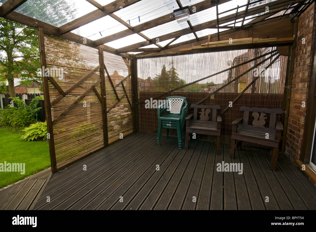 https www alamy com stock photo home built patio decking with corrugated plastic roofing and movable 31344464 html