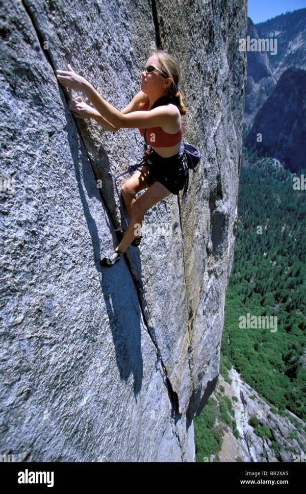 Woman Lead Climbing Big Wall High Angle Perspective Stock Royalty Free