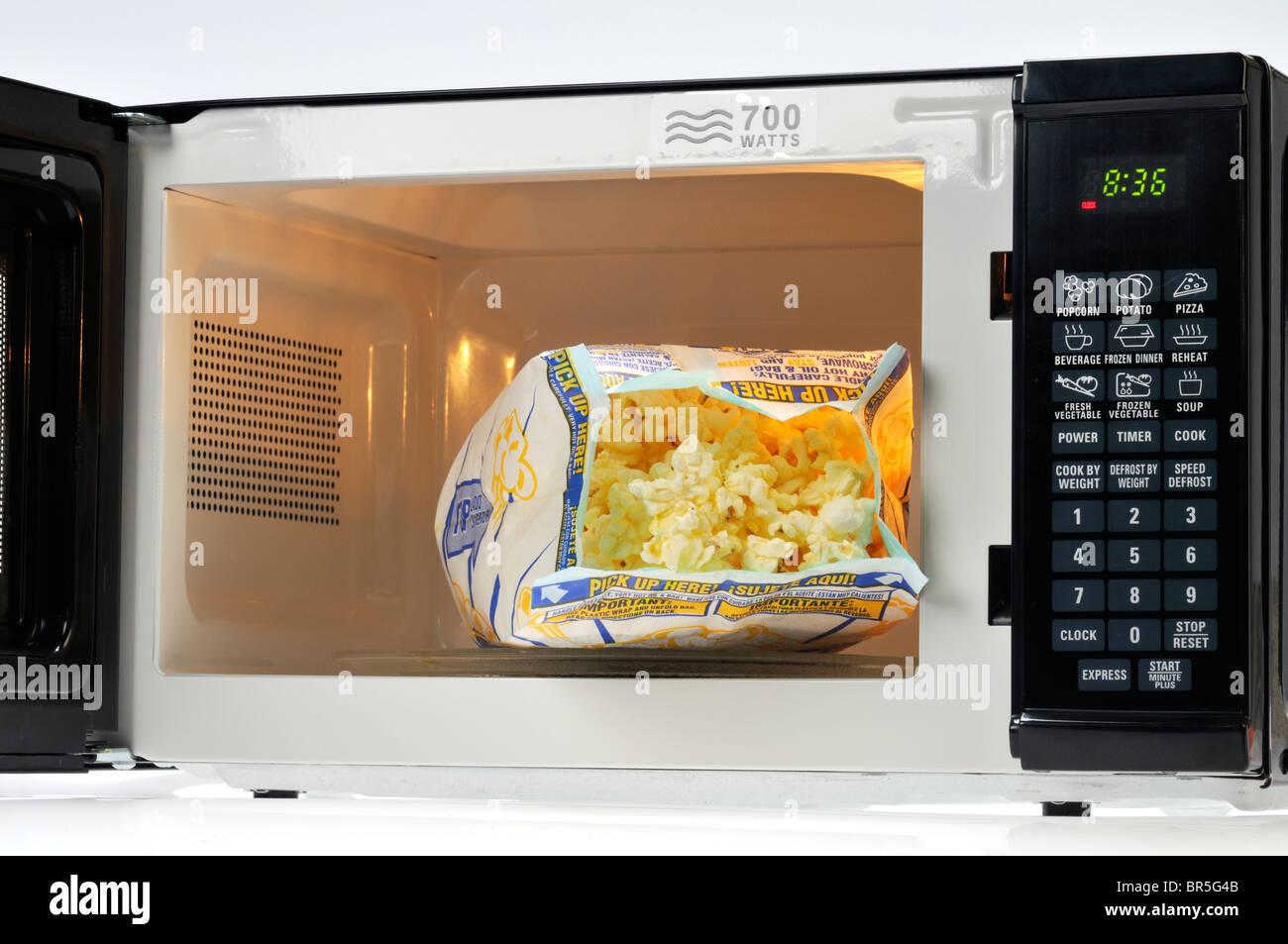 https www alamy com stock photo open bag of pop secret microwave popcorn in microwave oven usa 31469883 html