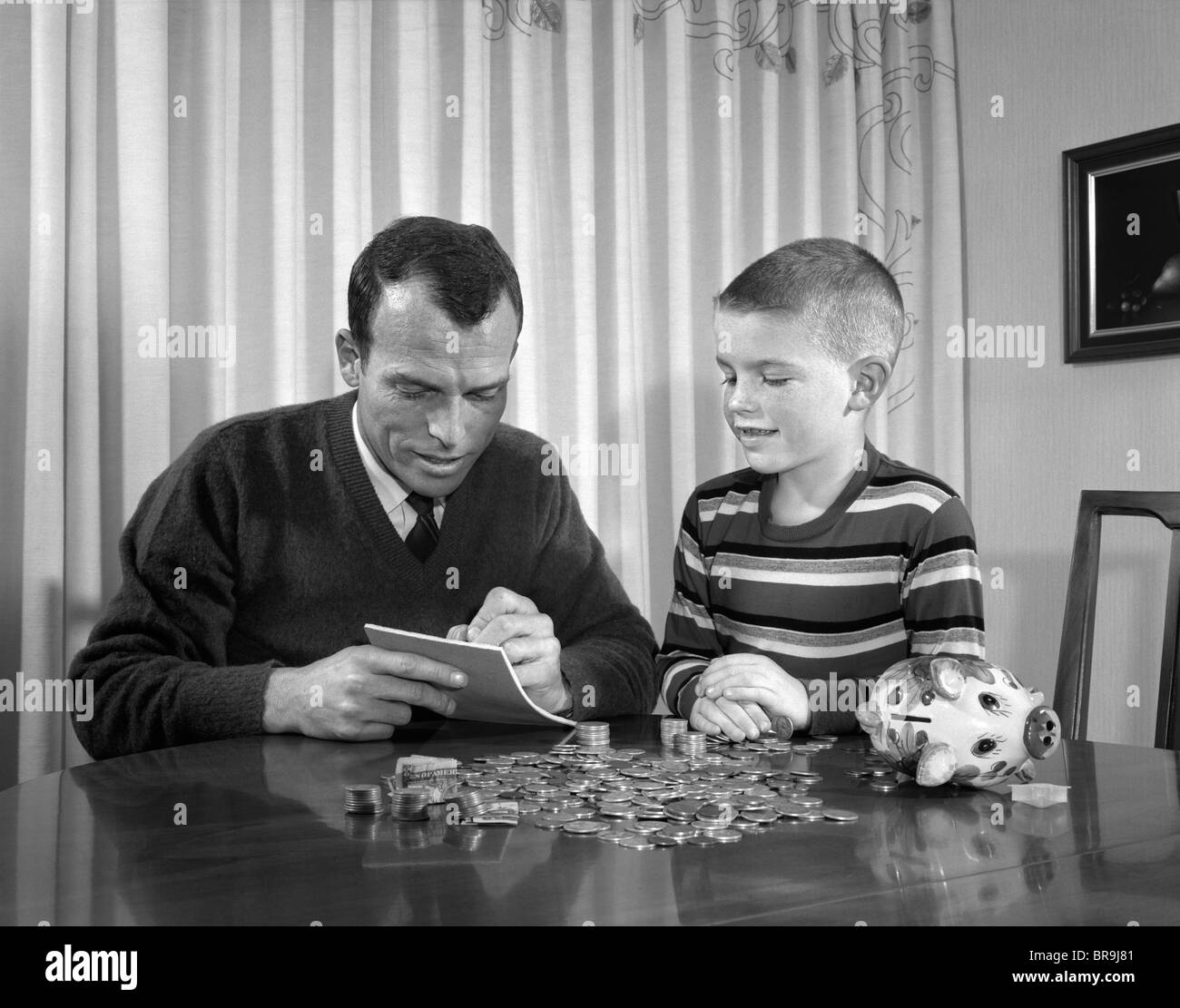 S Father Son With Piggy Bank Counting Money Coins