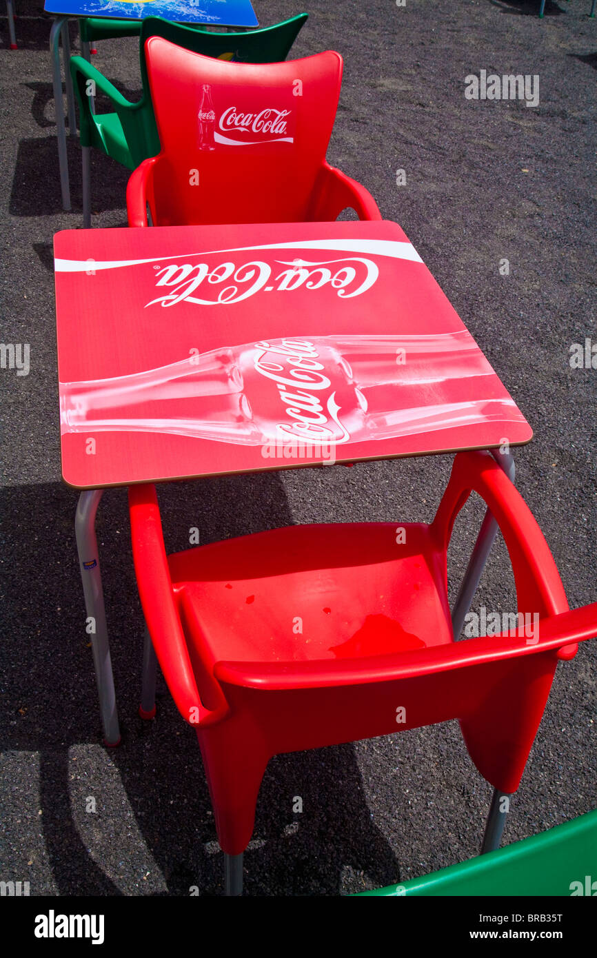 coca cola chairs and tables cheap walmart bright red plastic logo table at restaurant on the sea front playa quemada lanzarote