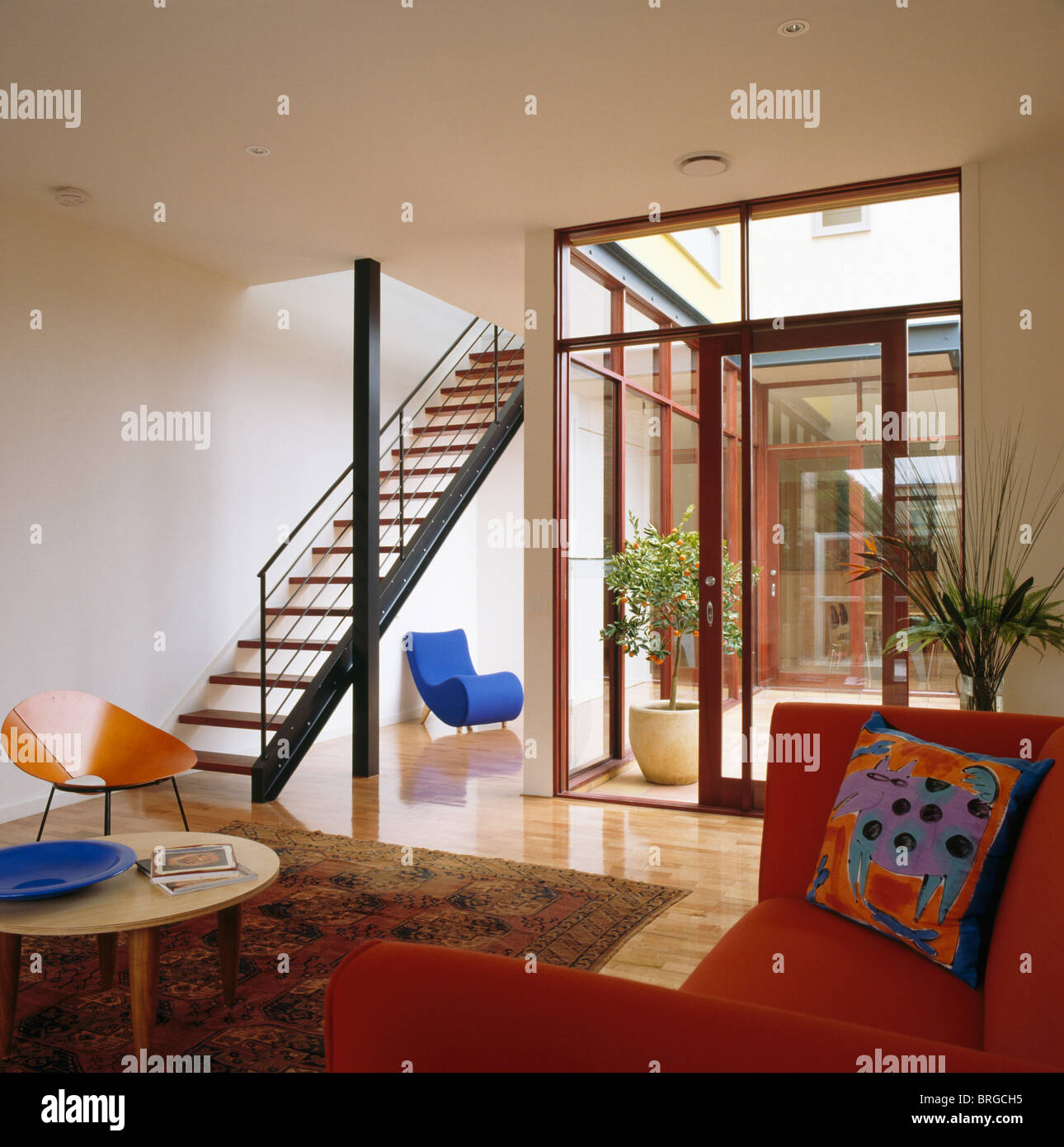 open plan staircase in living room decor pictures for rooms red sofa and tread metal modern with glass doors to atrium