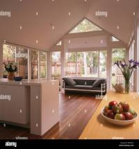 Modern white open-plan kitchen and living room extension ...