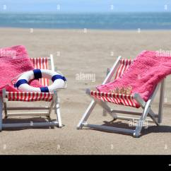 Pink Beach Chair High Chairs Blue Towel Stock Photos On The With Towels And Life Buoy Image