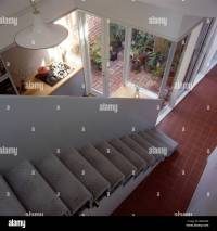 Looking down open staircase with gray carpet and no ...