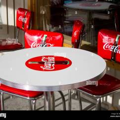 Coca Cola Chairs And Tables Faux Fur Saucer Chair Red Around A White Table Stock Photo