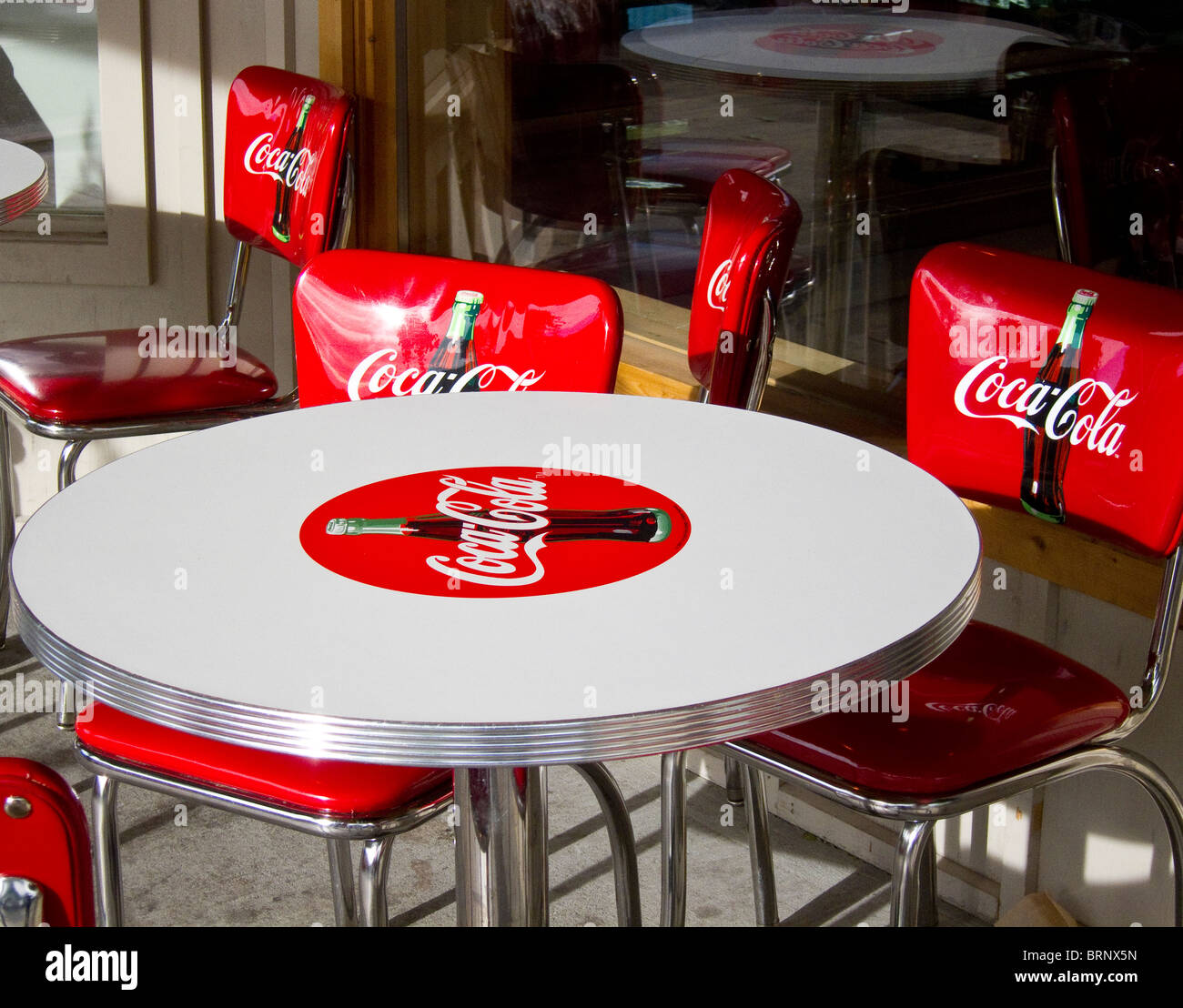 Coca Cola Table And Chairs Red Coca Cola Chairs Around A White Coca Cola Table Stock