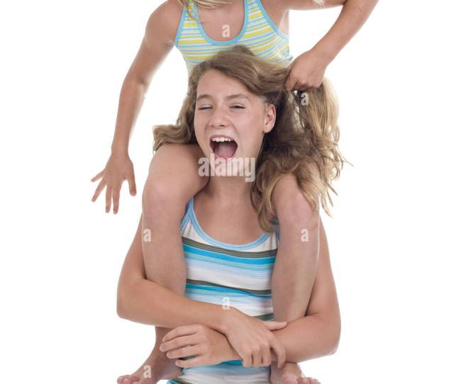 Playful Young Naughty Sisters Having Fun Isolated On White