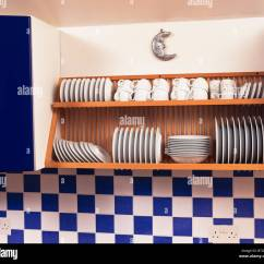Wooden Kitchen Plate Rack Cabinet Flooring For Close Up Of White Crockery On Above Blue