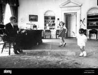 John F. Kennedy, in Oval Office with children Caroline ...