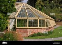 wood and brick greenhouse in gardens at Greenway house ...