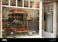 A French Patisserie shop window in the town of Dinan ...