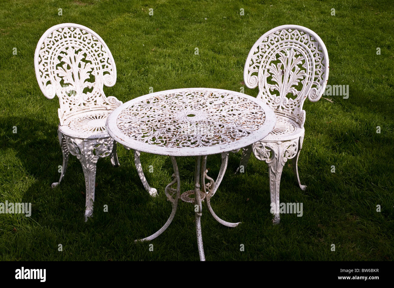 old metal chairs white dining room johannesburg style and table on a garden lawn dartmoor stock