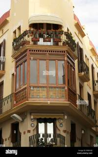 Wooden balcony in a building in Sitges, Spain Stock Photo