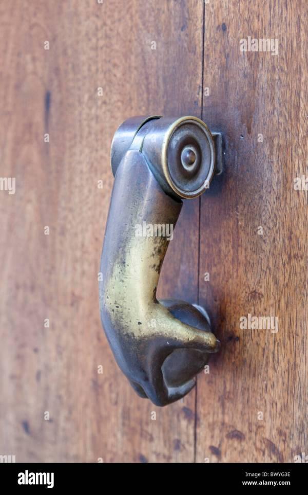 Hand And Ball Door Knocker Stock &