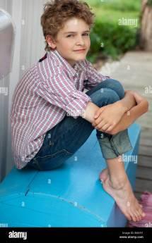 Portrait Confident Brunette Barefoot Boy Stock
