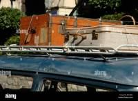 Vintage Luggage or Suitcases Tied to Old Roof Rack on Old ...