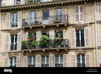 Paris apartment building balcony with flowers Stock Photo ...