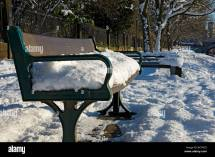 Park Bench Snow Uk Stock &