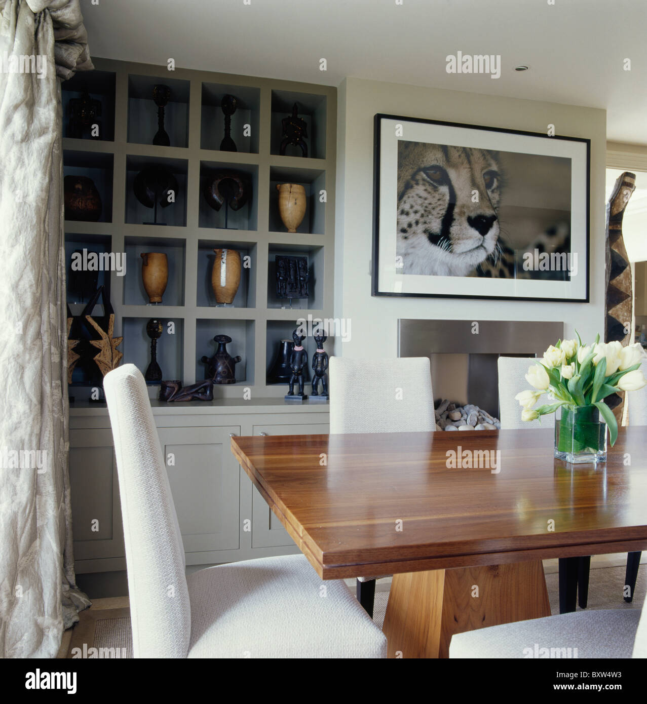 Large picture above fireplace in cream dining room with cube alcove Stock Photo Royalty Free