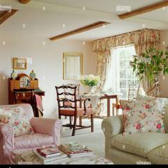 Green Cushions Living Room Cute Curtains Pink Floral On Armchair And Pale Sofa In Cottage With Cream Carpet