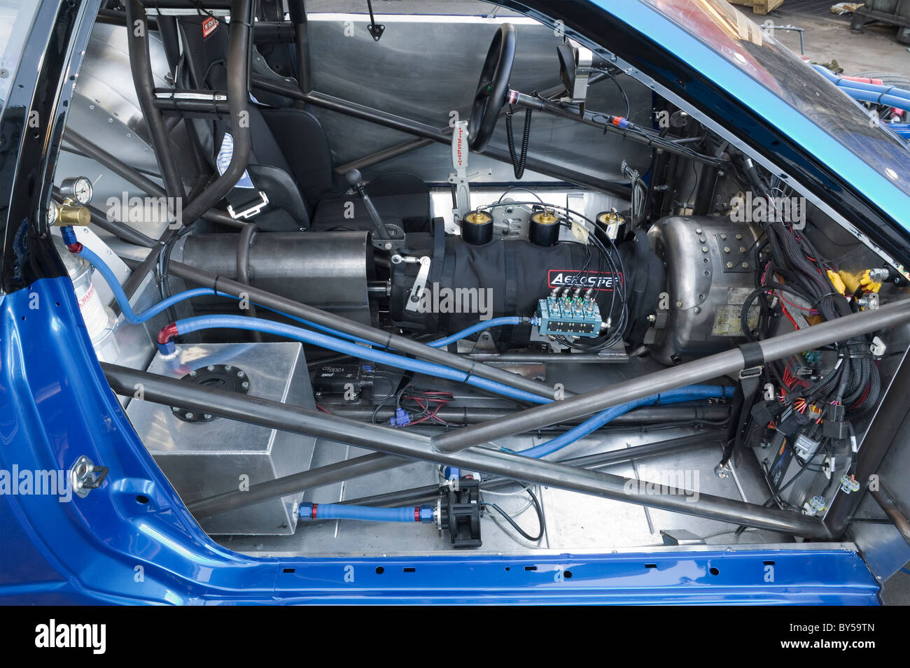 hight resolution of cockpit in a drag racing car showing components and parts such as gearbox safety cage gear shifter electrical parts etc