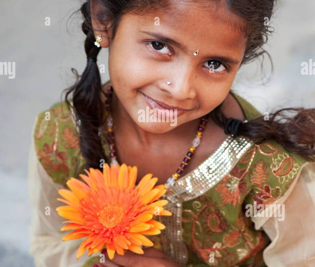 Smiling Pretty Young Indian Girl Holding Orange Gerbera Flower Andhra Pradesh India