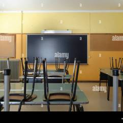 High Chair Upside Down Rooms To Go Living Room Chairs Empty Classroom With On Desks Stock