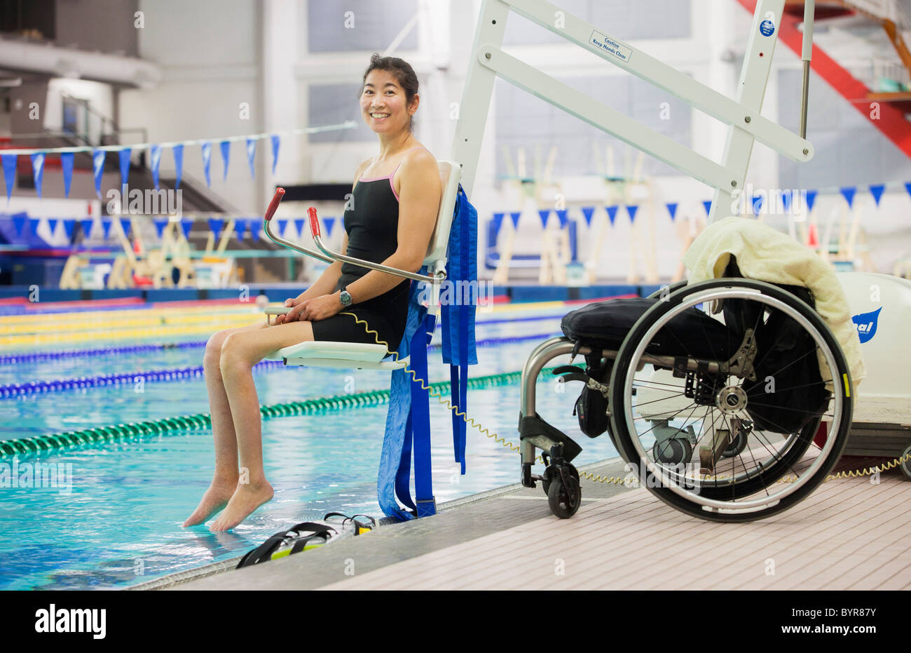lift chairs edmonton alberta lowes patio a paraplegic woman enters swimming pool on with