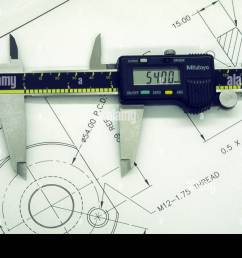 digital vernier caliper on an engineering drawing stock image [ 1300 x 956 Pixel ]