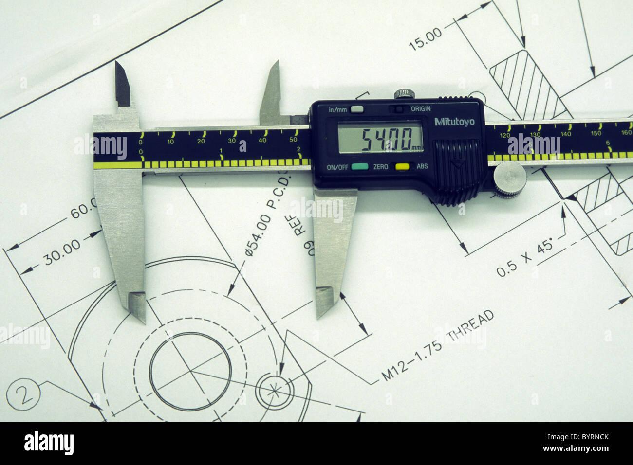 hight resolution of digital vernier caliper on an engineering drawing stock image