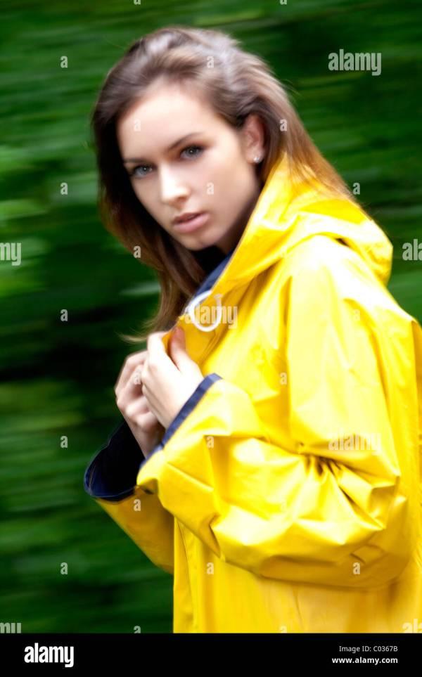 Girl Wearing Yellow Raincoat Stock 34491503 - Alamy