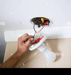 electrician fixing lightbulb wiring stock image [ 1300 x 956 Pixel ]