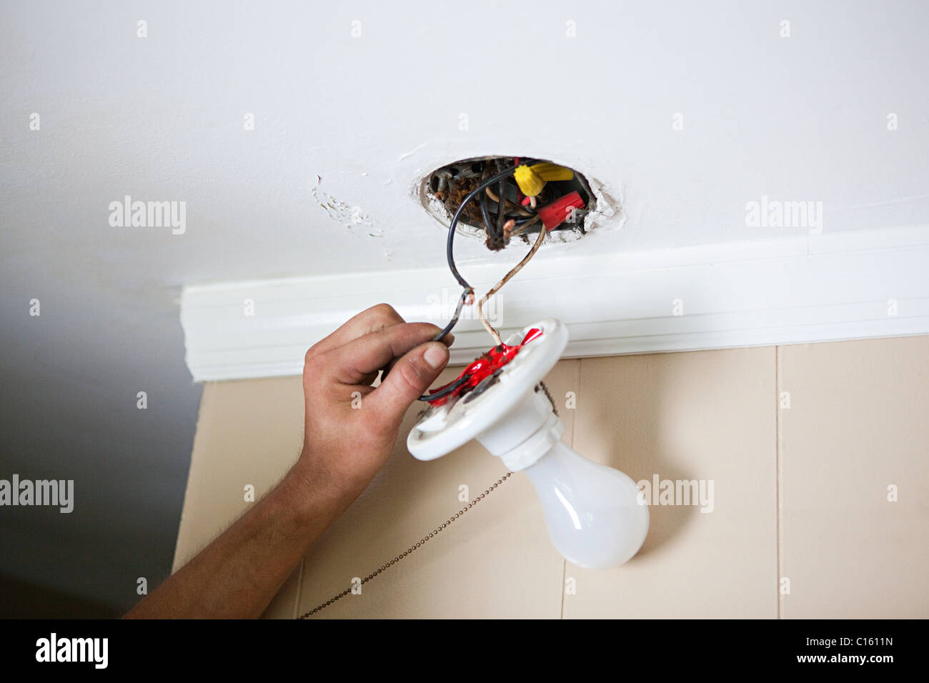 hight resolution of electrician fixing lightbulb wiring stock image