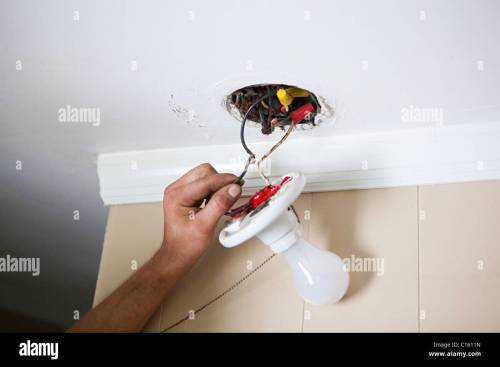 small resolution of electrician fixing lightbulb wiring stock image