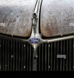 1936 ford coupe hood badge v8 stock image [ 1300 x 956 Pixel ]