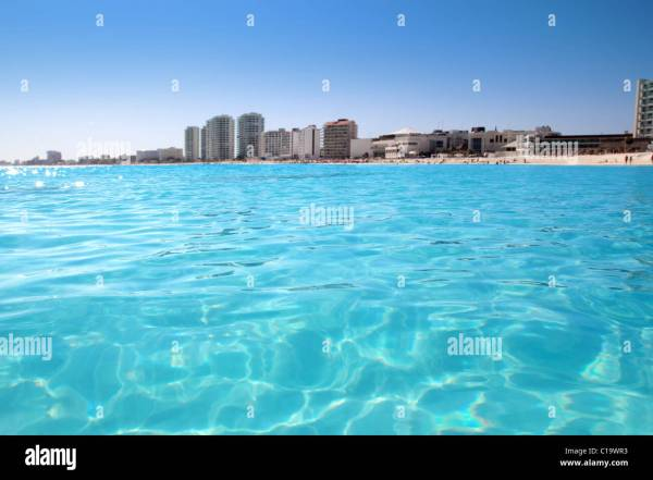 Cancun beach view from turquoise Caribbean water vacation