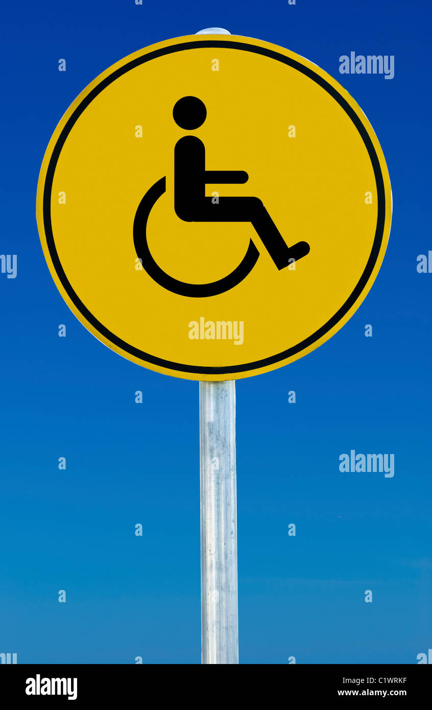 yellow wheelchair polywood outdoor rocking chairs sign on road stock photos picture a isolated blue graduated sky image