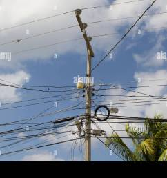 messy wires on an electric pillar in roatan honduras stock image [ 1300 x 956 Pixel ]