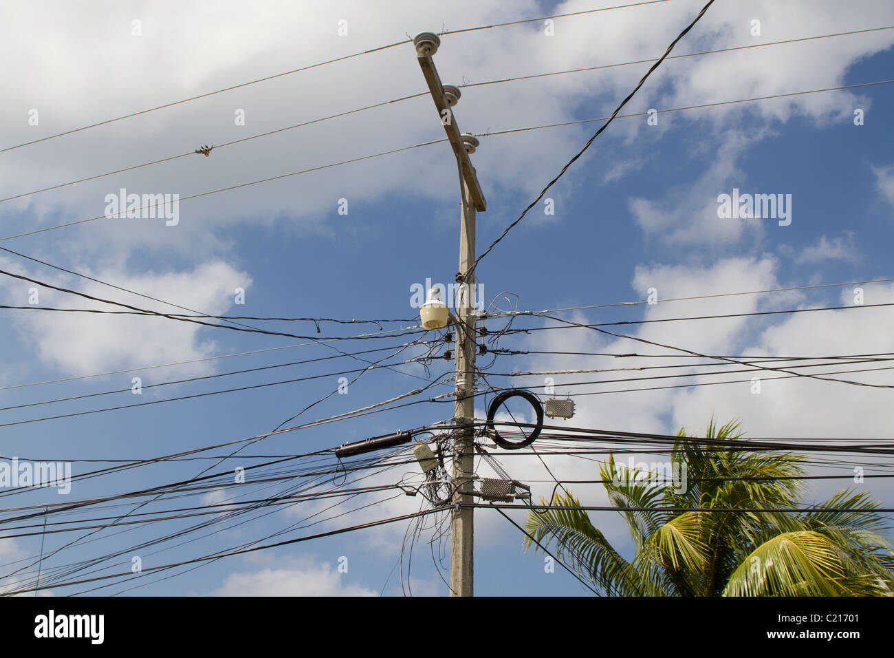 hight resolution of messy wires on an electric pillar in roatan honduras stock image