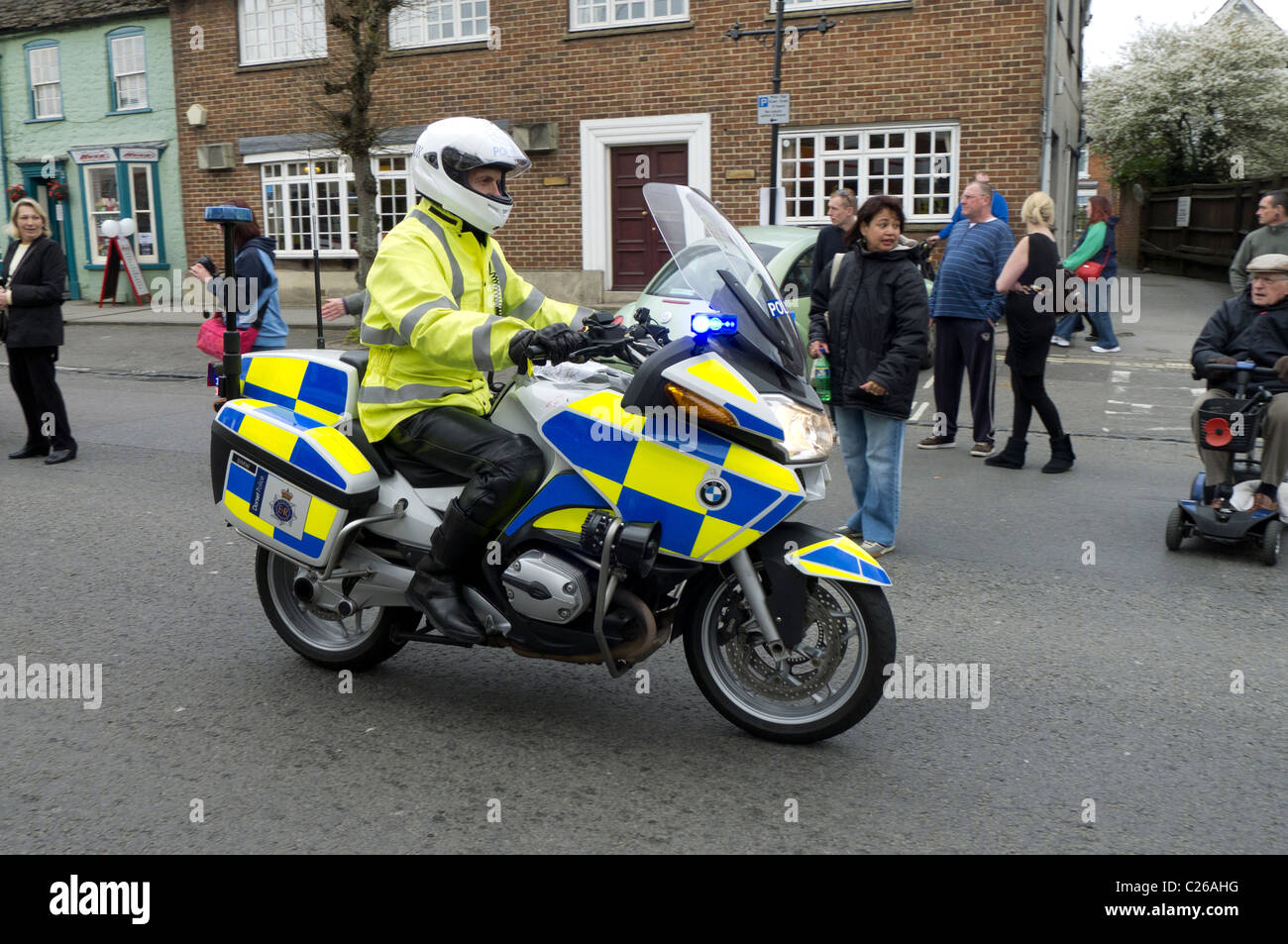 hight resolution of dorset police motorcyclist rides his bmw patrol bike along wootton bassett high street during the ride