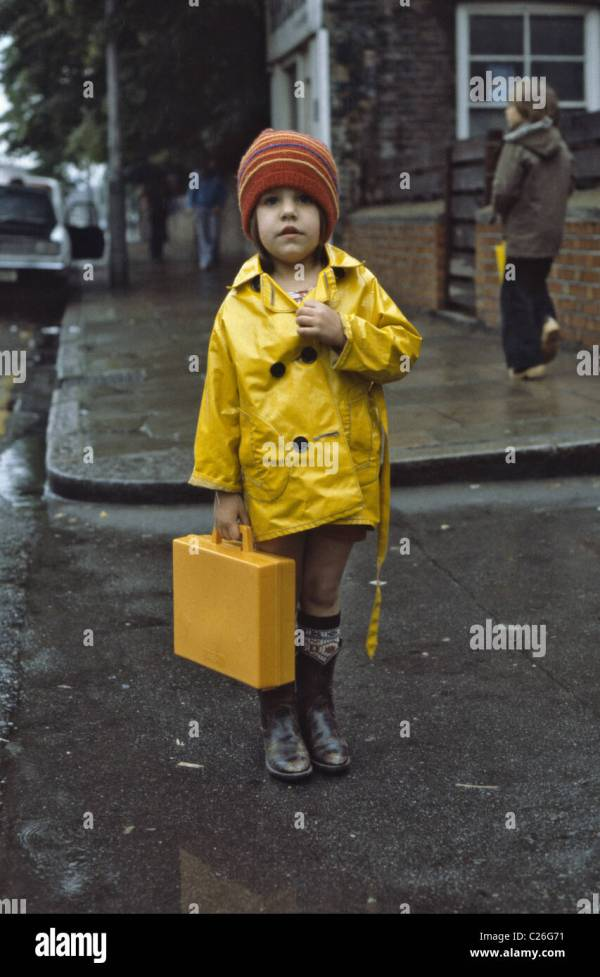 Young Girl Wearing Yellow Raincoat Holding